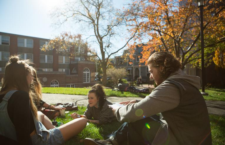 Students on the lawn of the Quad during Autumn