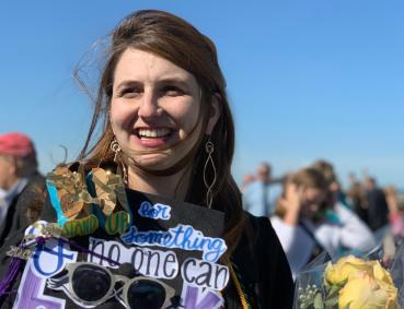 Katya Zinn is pictured smiling amid the crowd at Lesley Commencement