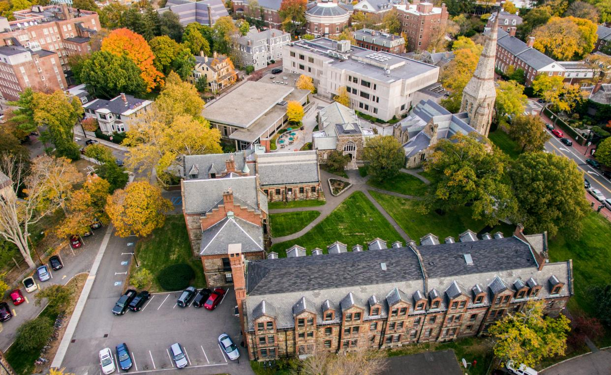 An overhead shot of Brattle campus and the City of Cambridge with buildings and fall foliage.