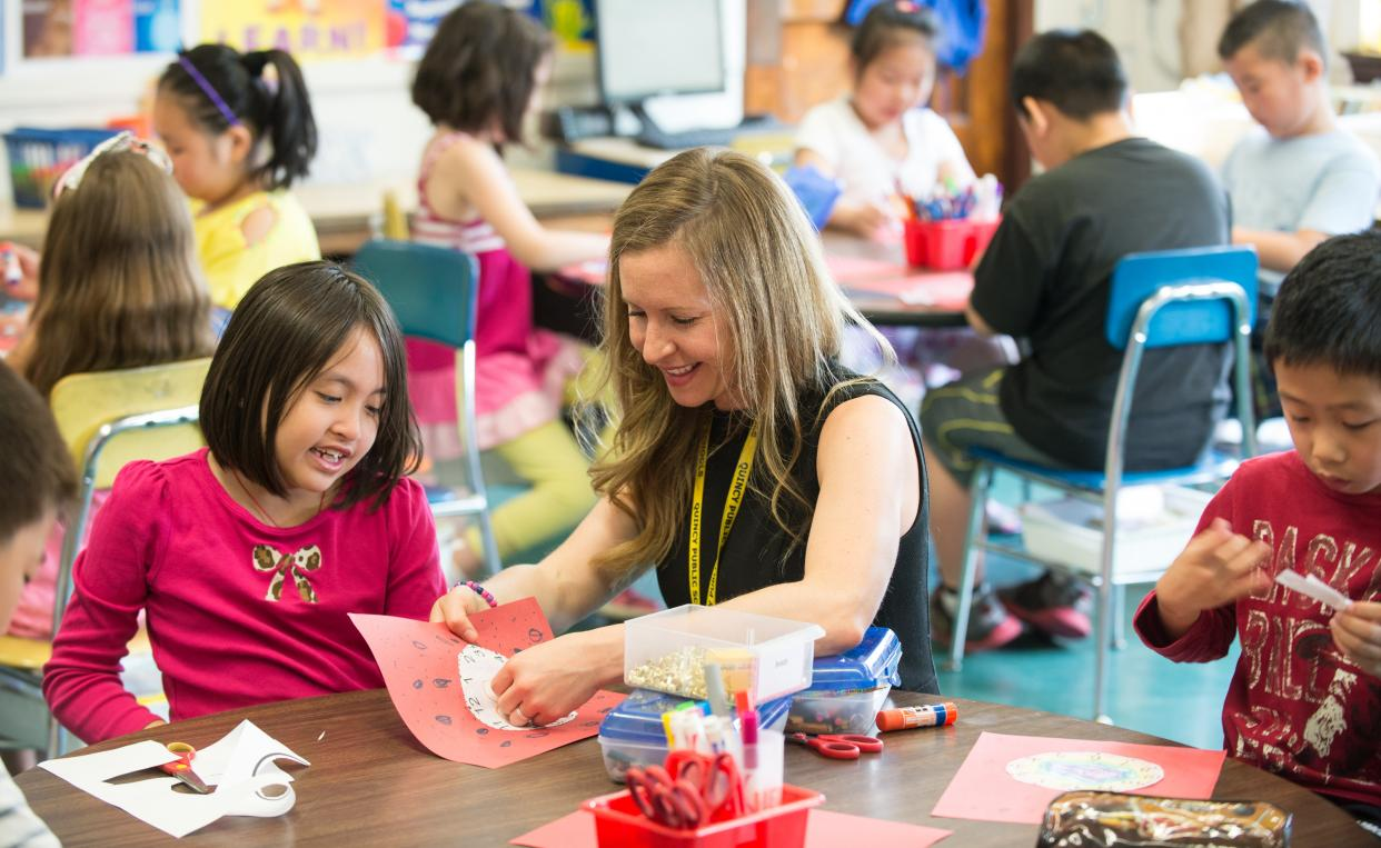 teacher doing art and crafts with a student