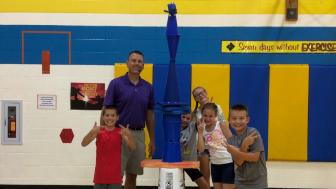 Chris Wendorf with kids in a gym.