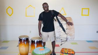 Jonathan Mande with five of his drums.