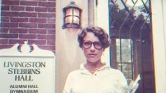 Vintage shot of Joan Velsmid in front of Stebbins Hall.