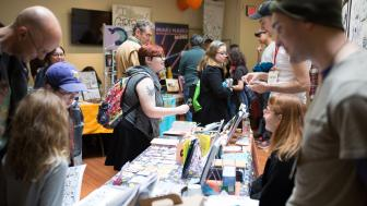 Massachusetts Independent Comics Expo tables, books, exhibitors, and visitors