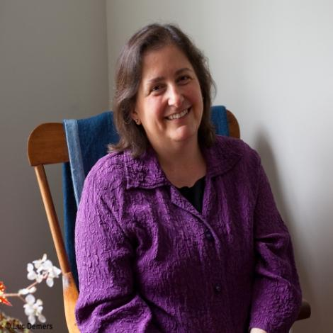 faculty jane brox sitting in rocking chair