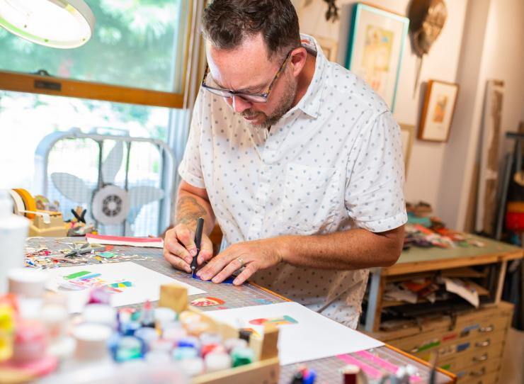 Artist Keith MacLelland working in his studio