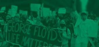 Green filter layered over image of protesters holding various Black Lives Matter-themed signs