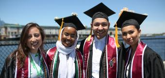 Four students pose at Commencement