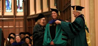 A doctoral candidate is hooded