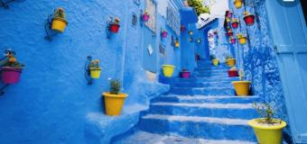 An alley in Chefchaouen, the blue city in Morocco, steps and walls painted bright blue