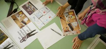 students look over print design layouts