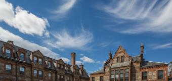 Wispy clouds and a blue sky over Lawrence Hall.