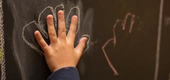 hand with chalk outline Center for Special Education
