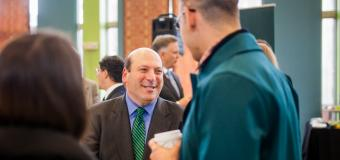 president jeff weiss engaging in conversation
