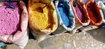 Sacks of brightly colored spices in Morocco