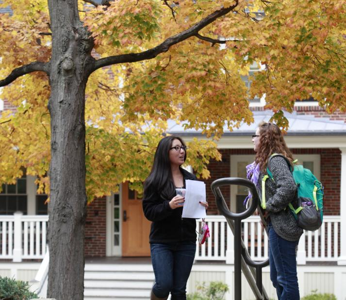 Two students on the steps of Doble quad in Fall