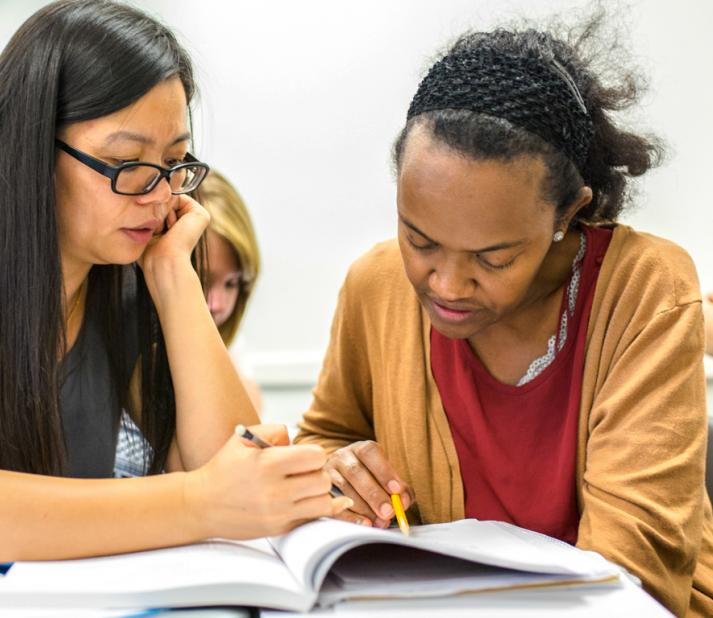 2 female students studying in classroom at Bunker Hill Community College