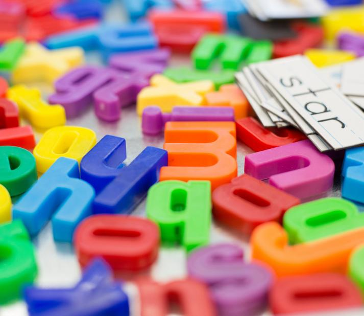Colorful Alphabet Letters on Children's Classroom Table
