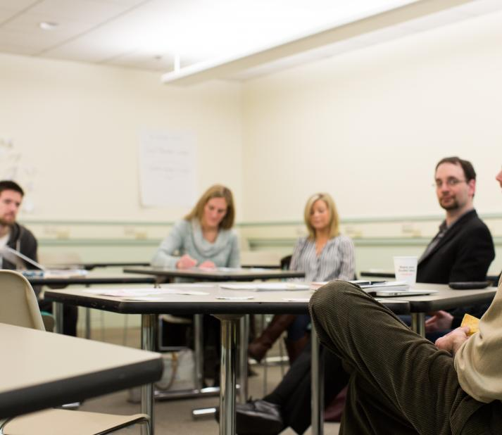 faculty leading group discussion