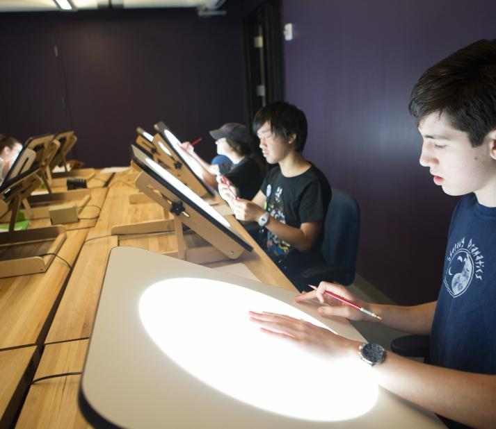 animation student using lightboxes