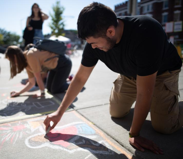 students drawing on sidewalk with chalk