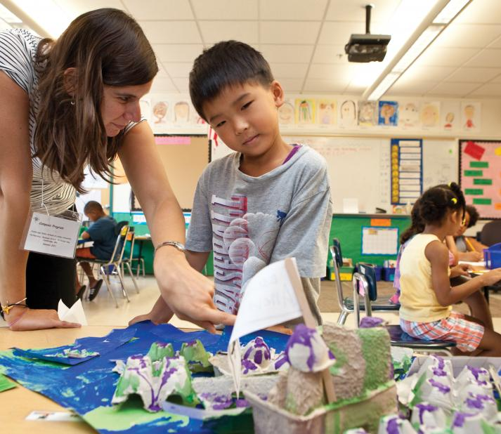 teacher and student doing crafts
