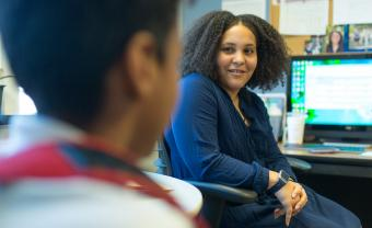 middle school counselor listens to a student in her office