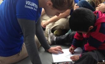 Lana Sommers, Lesley University alum, volunteering with children abroad