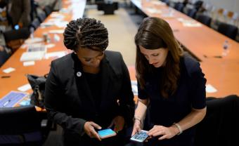 Sarah Groh and U.S. Representative Ayanna Pressley working together by Meredith Nierman, WGBH News