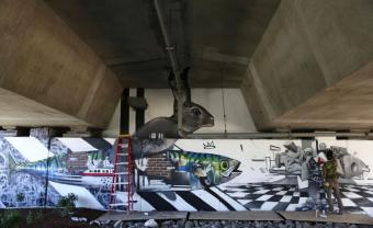 large mural on highway underpass
