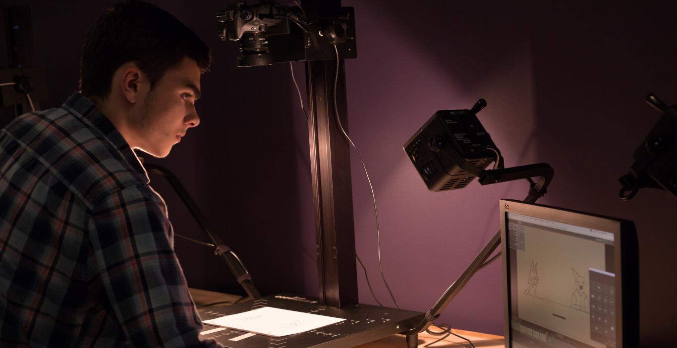 student at stop motion station in the animation studio