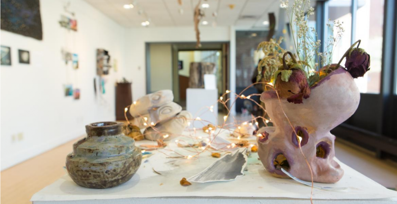 exhibition with pottery and other ceramic items on display in gallery