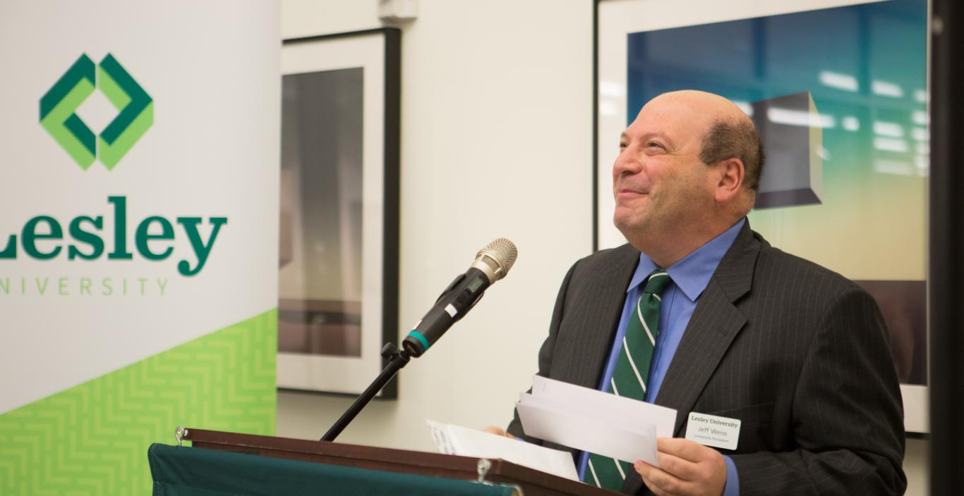 President Jeff Weiss at the podium at Lesley University