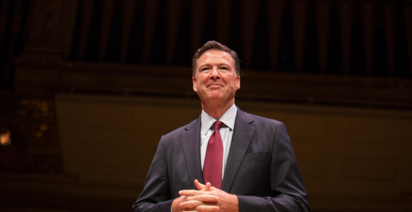 James Comey standing on the Symphony Hall stage