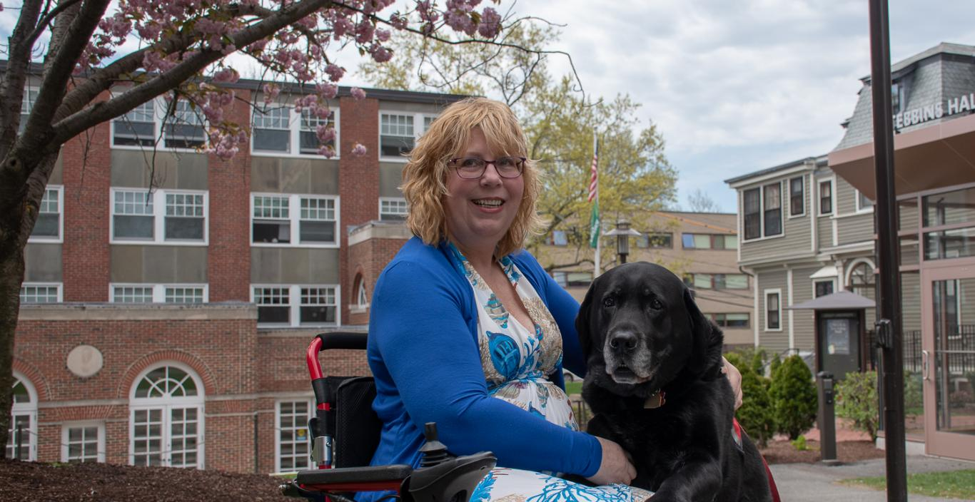 Dee Genetti and her service black lab service dog