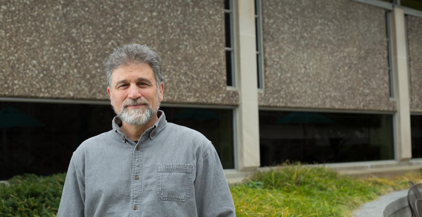 Professor Mitchell Kossak in front of Sherrill Library.