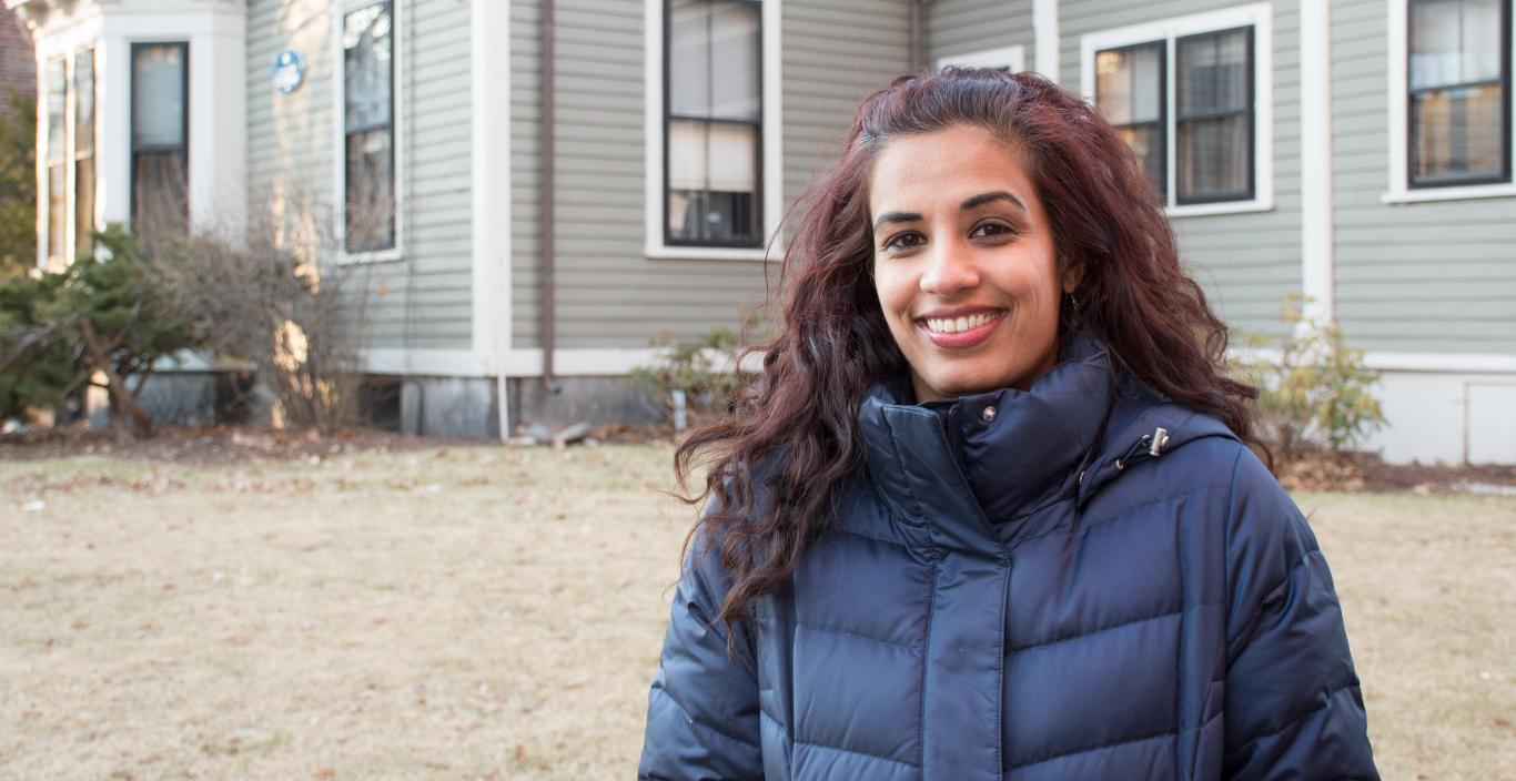 Outdoor shot of Mariya Taher in front of 29 Everett (founder's house at Lesley).
