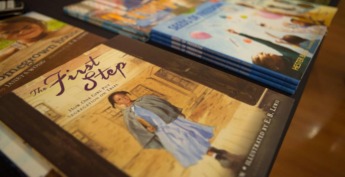 "Susan Goodman's picture book, ""The First Step,"" is on a table."