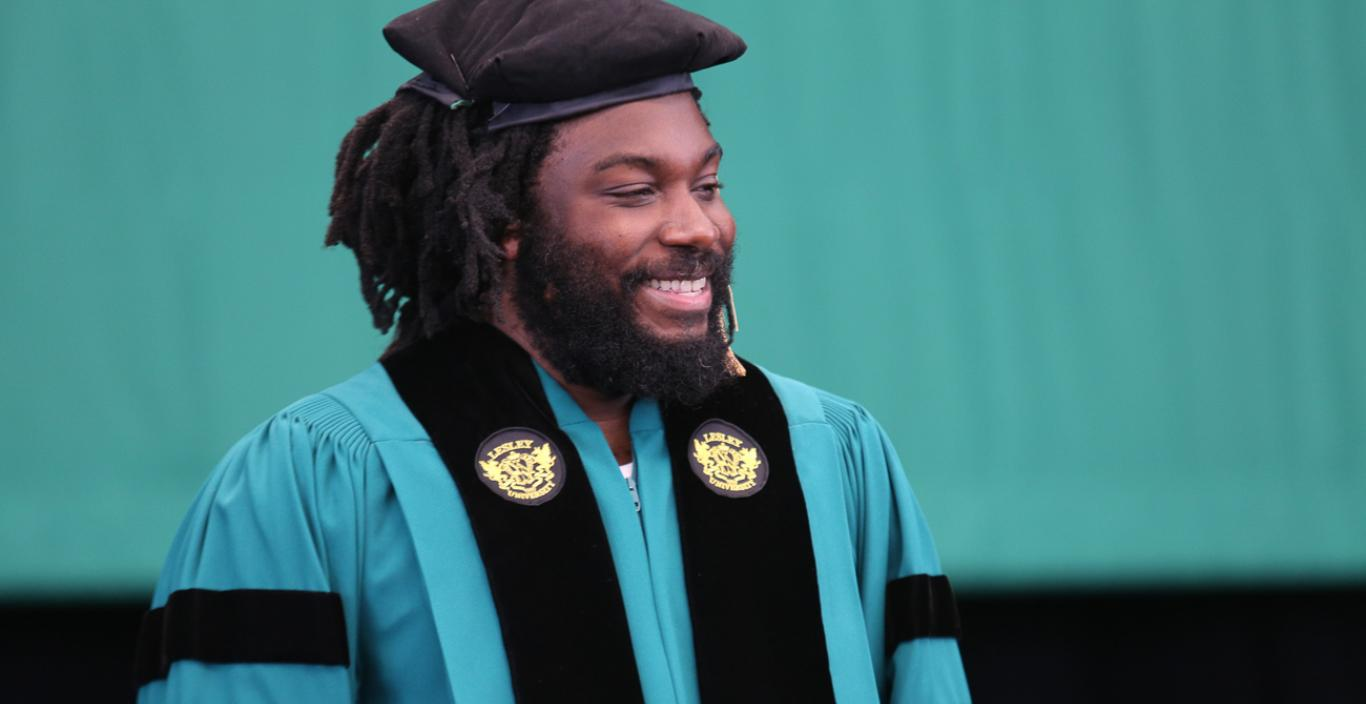 Jason Reynolds in regalia at Commencement 2018