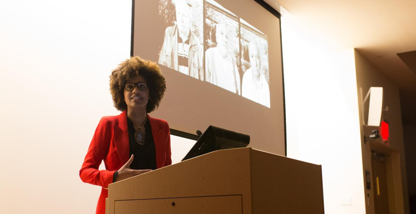 Latoya Ruby Frazier speaks at a podium.