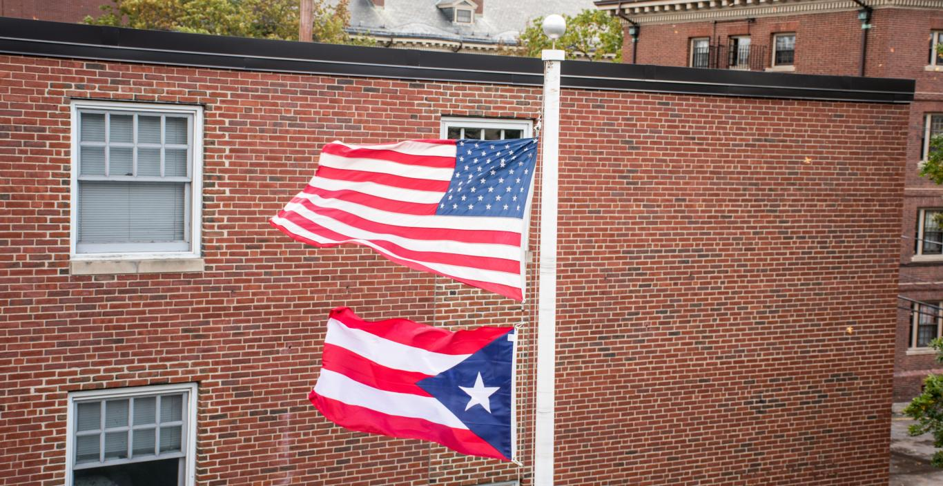 The Puerto Rico flag flies below the American flag on campus.