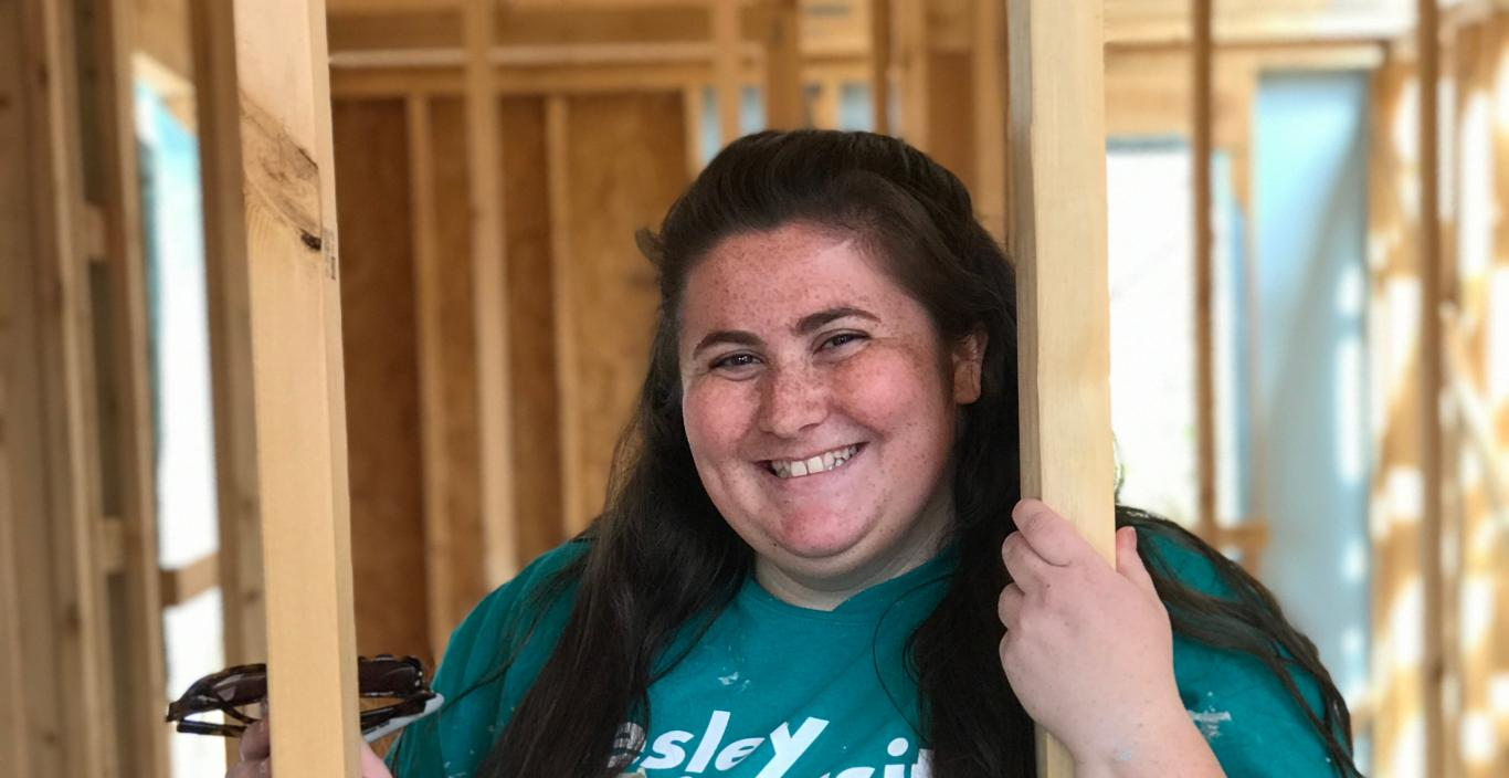 Rachel DiGangi inside a halfway built Habitat for Humanity home in North Carolina.