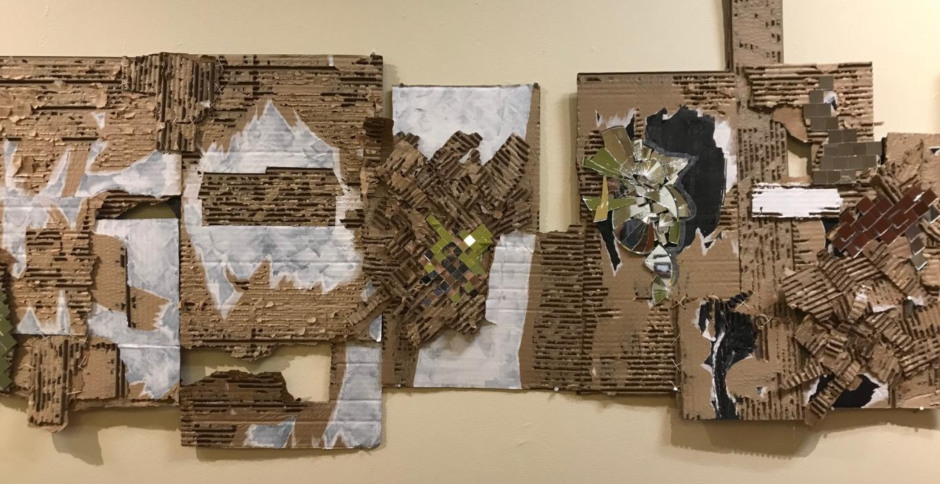 A piece from the show, an arrangement of corrugated cardboard and other materials.