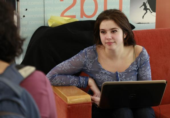 student lounging with computer