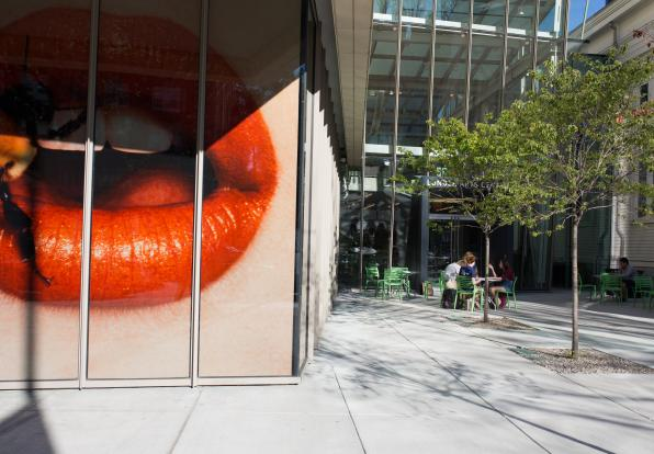 A larger than life Irving Penn photo of red lips taken from outside Lunder Art Center
