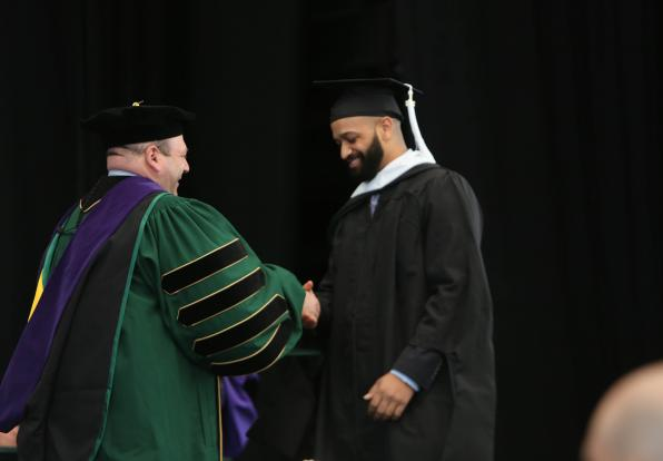 Jesse Sparks receives his diploma from President Jeff Weiss
