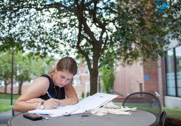 female writing outside