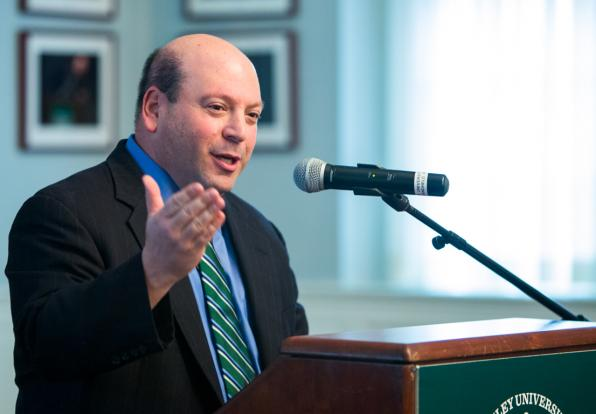 university president Jeff Weiss speaking at a podium