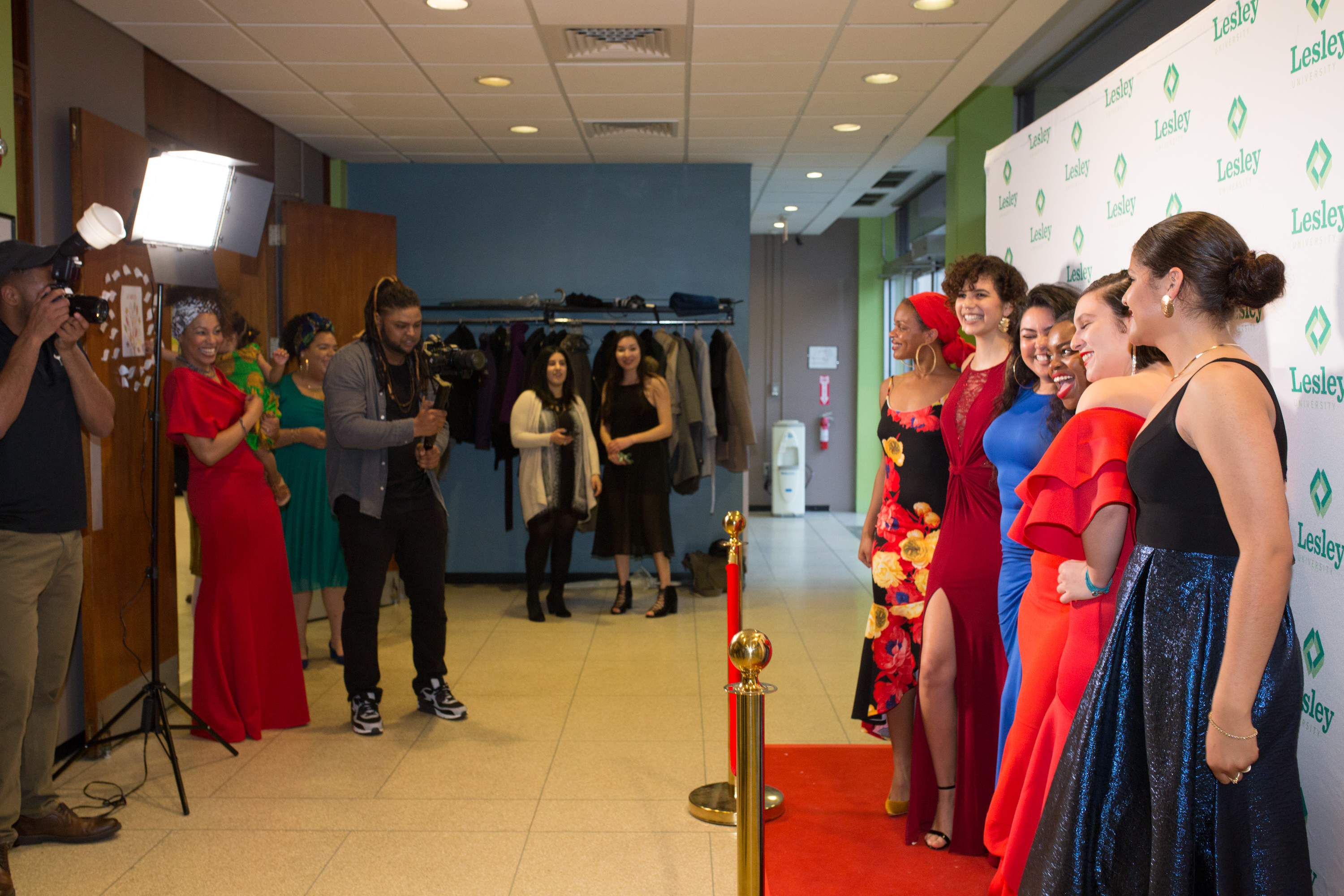 Students pose on the red carpet at the Unity Gala in Washburn Hall.
