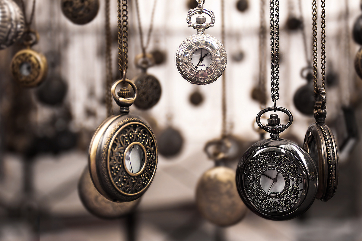 Photograph of vintage pocketwatches hanging by chains